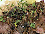 Seared and Carved Beef Tenderloin with Herb Quinoa, Poached Leeks and Wild Mushroom Reduction
