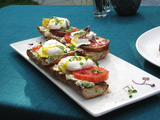 Poached Eggs on Toasted Baguette with Goat Cheese, and Black Pepper Vinaigrette