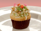 Winning Recipe Mini Coconut Cupcakes with Poppy Seed Crust, Muscat Raisin Filling, and Parsley Icing with Toasted Coconut, Flax and Poppy Seed Toffee, and Organic Roses