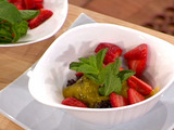 Black Sticky Rice Pudding with Strawberries and Mango Syrup