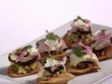 Pork Tenderloin Nachos with Mornay Sauce, Avocado-Corn Relish, Charred Jalapeno and Goat Cheese