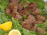 Beef Tenderloin Bites on a Bed of Arugula