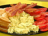 Herb and Egg Scramble with Garlic Toast and Sliced Tomato