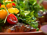 Rosemary-Garlic Steaks with Arugula, Tomatoes and Parmigiano-Reggiano
