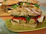 Grilled Eggplant and Fresh Mozzarella on Ciabatta with Roasted Red Peppers, Garlic Mayonnaise, Fresh Basil and Arugula