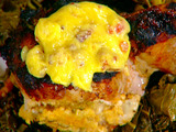 Smoked Oyster Dressing Stuffed Pork Chops with Andouille Hollandaise and Smothered Greens