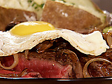 Beer Marinated T-Bone Steak, Sauteed Onions and Mushrooms, Topped with a Fried Egg