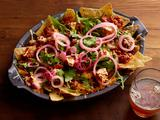 Spicy Sausage Ragu Nachos With Pickled Onions