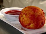 Papa Rellena con Salsa Ranchera (Stuffed Potato with Spicy Creole Sauce)