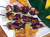 Bob Marley's Reggae: Jerk Marinated Chicken Breast Skewers, Chargrilled and Served with Creamy Cucumber Dipping Sauce and Yucca Fries