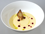 Yukon Gold Potato Soup with Chive Oil, Beet Reduction and Sweet Garlic Confit Croutons