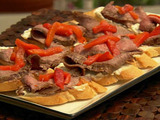 Molasses Marinated Flank Steak with Roasted Red Peppers