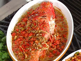Whole Fish Baked in Tomatoes, Onions, and Garlic