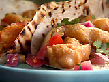 Cerveza-Battered Fish Tacos with Quick-Pickled Onion and Cucumber