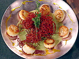 Pan-Seared Scallops with a Fried Red Beet Nest, English Pea Puree, and Curry Oil
