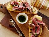 Mini Open Faced Steak Sandwiches on Garlic Bread with Aged Provolone and Parsley Oil