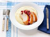 Sliced Chipotle Turkey Breast With Pomegranate Cranberry Relish and Polenta