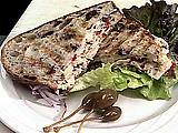 Tuna and Artichoke Salad on Kalamata Olive Bread with Provolone Cheese and Fresh Herb and Garlic Aioli