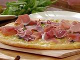 Cornmeal Crusted Pizza with Prosciutto, Green Peas, Fontina and Parmigiano-Reggiano