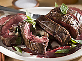 Red Wine Marinated Flank Steak Filled with Prosciutto, Fontina and Basil with Cabernet-Shallot Reduction