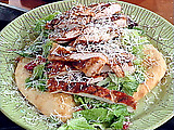 Parmesan Pizza Crust filled with Emeril's Kicked Up Chicken Caesar Salad