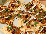 Flatbread with White Bean Hummus, Caramelized Onions, Black Olives and Spanish White Anchovies