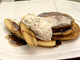 Pumpkin Pancakes with Root Beer Syrup, Caramelized Bananas, and Cinnamon Whipped Cream