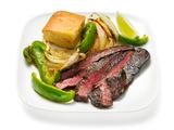 Coffee-Rubbed Steak With Peppers and Onions