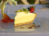 Cashew Crusted Key Lime Pie with a Whipped Cream Fruit Coulis