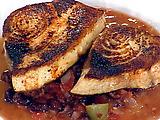 Fresh Swordfish with an Olive Tomato Sauce and Crispy Calamari