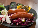 Braised Wurst Sausages with Cabbage, Red Onion and Apple Slaw