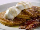 Orange Pumpkin Pancakes with Vanilla Whipped Cream, Cinnamon Maple Syrup and Thick-Cut Bacon