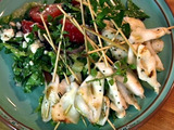 Classic Greek Salad Topped with Grilled Calamari Skewers