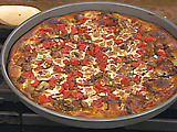 Chicago-Style Pan Pizza with Sausage, Mushrooms, Herbs and Tomatoes