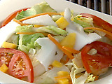Tossed Salad with Mango, Roasted Coconut and Lime Vinaigrette