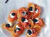 Gaufrette Potatoes with Gravlax, Sour Cream and Osetra Caviar