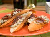 Crostini with Blue Cheese, Quince Paste and Cracked Black Pepper