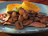 Flank Steak with Merlot Mushrooms and Pearl Onions over Toasted Polenta