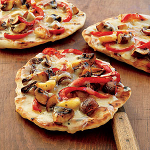 Pizza with Mushrooms, Peppers, Garlic, and Smoked Mozzarella