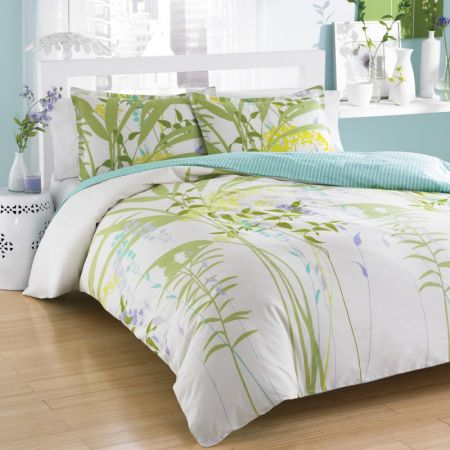white bedding with green bamboo design