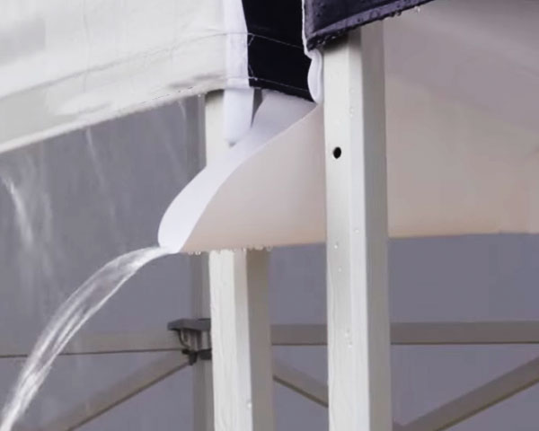 An easy to assemble tent gutter system attached to two pop-up tents.