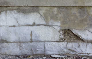 Cracked and crumbling concrete 0010