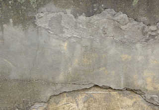 Cracked and crumbling concrete 0023