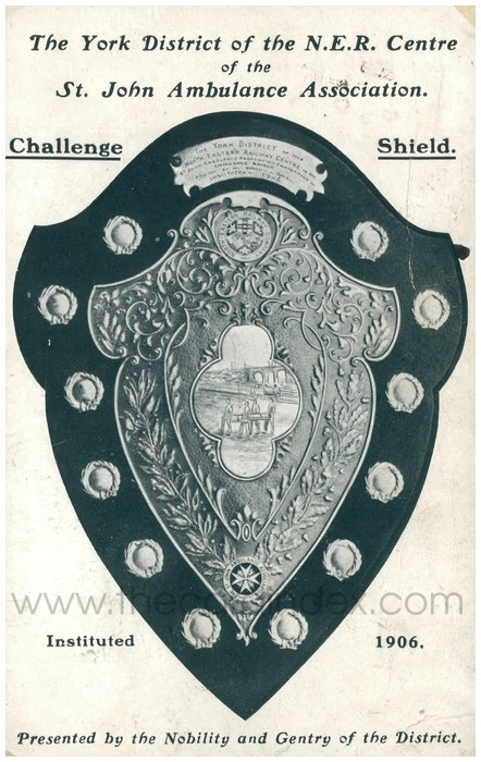 Postcard front: The York District of the N.E.R. Centre St. John Ambulance Association. Challenge Shield. Instituted 1906. Presented by the Nobility and Gentry of the District