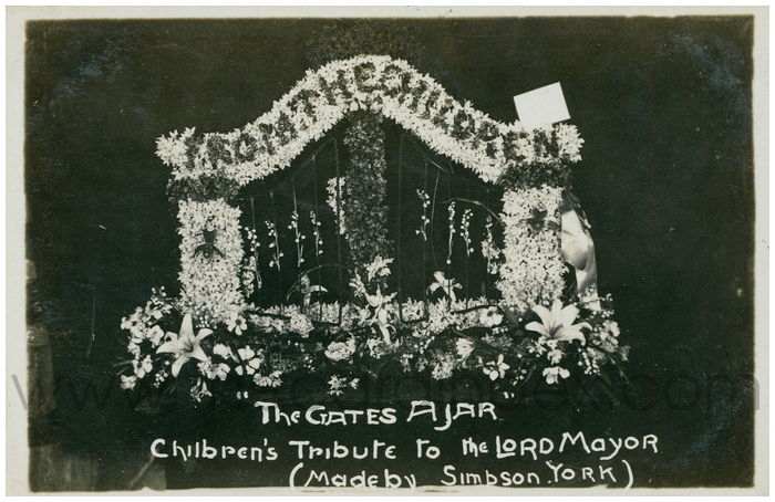 Postcard front: The Gates Ajar. Children's tribute to the Lord Mayor (Made by Simbson. York)