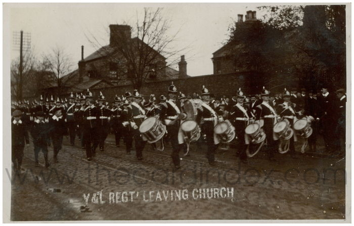 Postcard front: Y&L Regt' Leaving Church