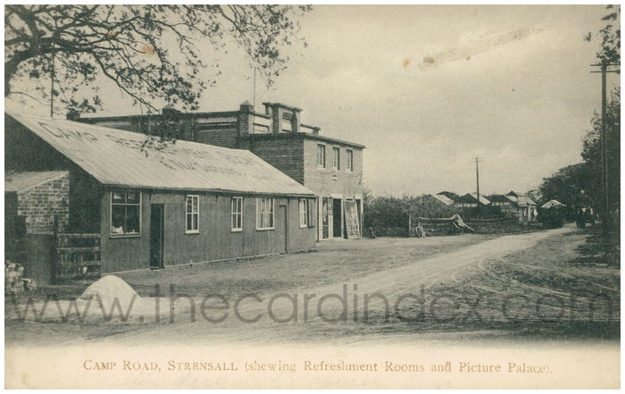 Postcard front: Camp Road, Strensall (showing Refreshment Rooms and Picure Palace).
