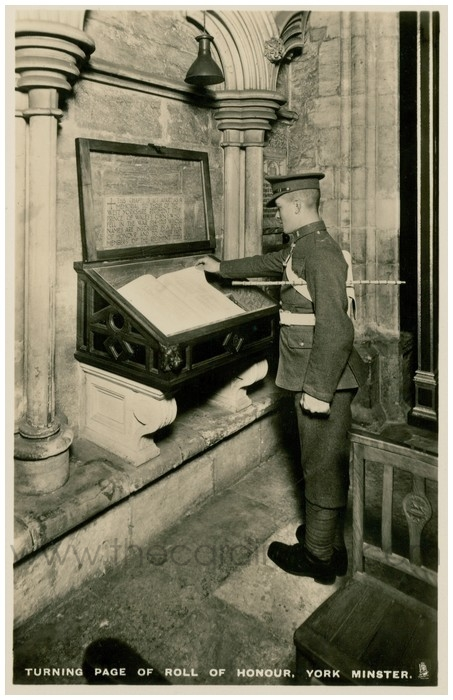 Postcard front: Turning Page of Roll of Honour. York Minster