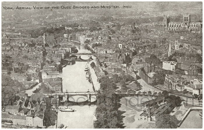 Postcard front: York. Aerial view of the Ouse Bridges and Minster
