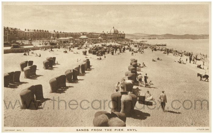 Postcard front: Sands from the Pier. Rhyl.